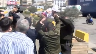 Man 'threatens to throw baby at police' amid heated scenes at Greek port