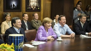 EU Commission President Juan Manuel Barroso (left), German Chancellor Angela Merkel and Britain's Prime Minister David Cameron.