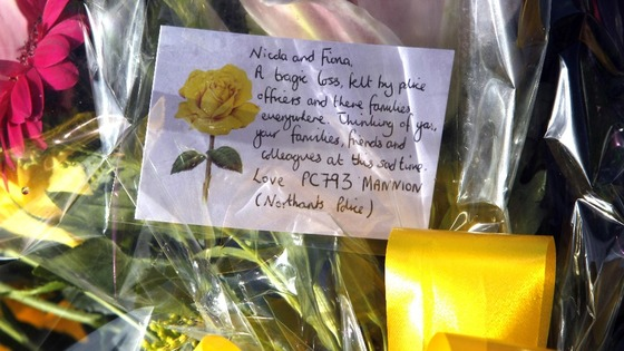 Floral tributes at the scene where PC Fiona Bone and PC Nicola Hughes were killed.