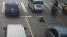 The child is left spread-eagle after falling out of the van