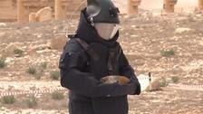 Russian troop in de-mining kit carrying a bomb