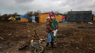 A young migrant in the Calais migrant camp