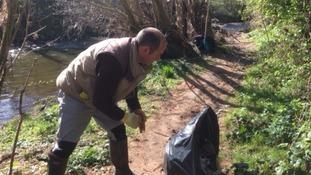 Volunteers helping to clear debris