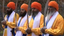 Sikhs with ceremonial swords