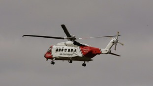 A coastguard helicopter that helped search for the missing crew