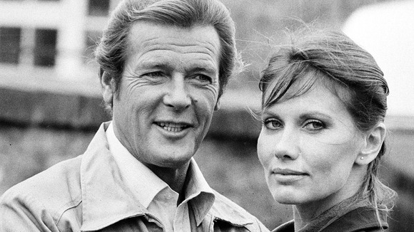 Roger Moore and Maud Adams on the set of Octopussy