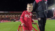 Oskar Pycroft walks onto the pitch ahead of Bristol City game
