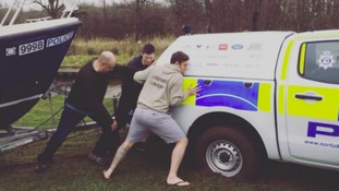 A stag party of 16 men helped Norfolk Police who were stuck in the mud on the Broads.