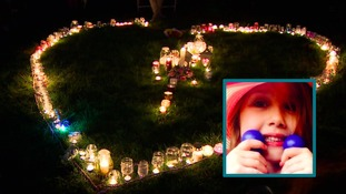A candle-lit vigil has been held for Summer Grant, 7, who died in a bouncy castle accident in Harlow.