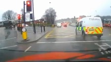 Footage captures police van going through a red light