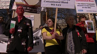 Families of victims of contaminated blood have been protesting outside the Houses of Parliament.