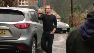Masters champion Danny Willett directs traffic after return home