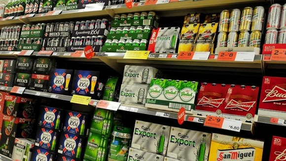 Supermarket shelves stacked with beer
