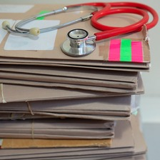 Stethoscope resting on some files