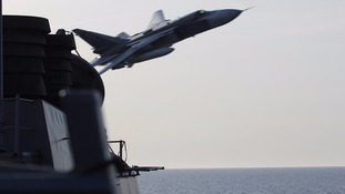 Footage shows Russian fighter jets flying 'dangerously close' to US warship