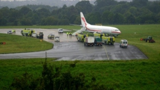 Plane skids off runway