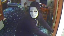 Three people entered the shop wearing balaclavas, hoods and masks.