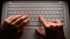 Somebody typing on a keyboard