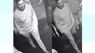A man in a black and white cctv image