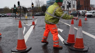 Workmen removing cones on Stonebridge