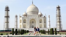 William and Kate sit in front of the Taj Mahal.
