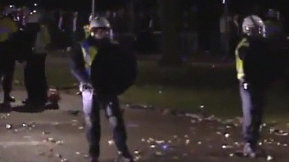 Riot police break up crowds of violent youths in Haren.