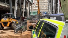 Police investigation after men fell from building site.
