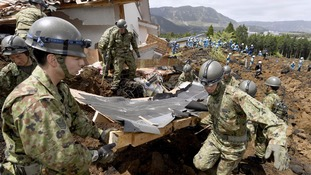 Rescue teams in Japan fear more trapped in quake debris as thousands evacuated