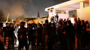 Demonstrators cheer after storming the headquarters of the Islamist Ansar al-Sharia militia group in Benghazi.