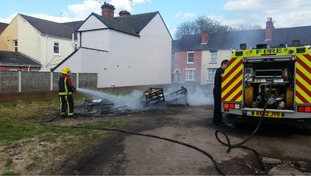 A sofa bed had been set on fire.