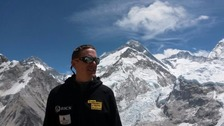 Man in front of Mount Everest