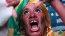 A supporter of the President reacts to news of the vote