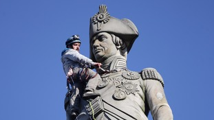 Activists scaled Nelson's Column on Monday morning