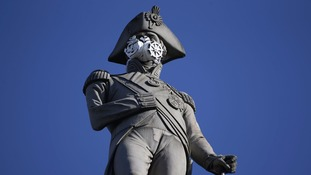 Nelson was among the London landmarks to be fitted with a pollution mask as part of the Greenpeace campaign