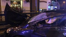 Metal railings prevented the car from smashing directly into a nearby pub
