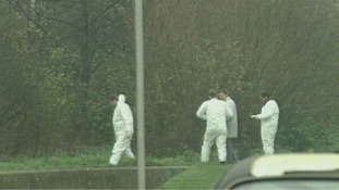 Forensic teams at the scene of the murder in Peterborough, 1994