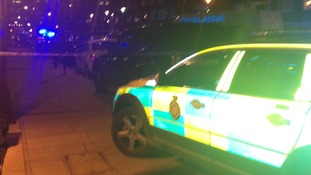 Police at the address in Byng Street in Canary Wharf, east London