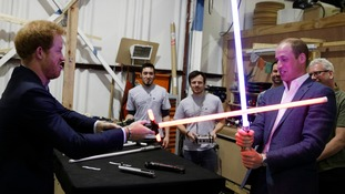 'Why am I the bad guy?' Harry grabs red lightsaber as he battles brother William on Star Wars tour at Pinewood studios