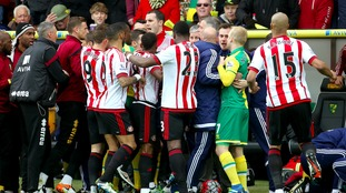 The players clashed following a tackle by Robbie Brady in front of the dugout.