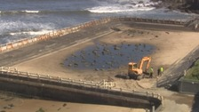 A digger in the middle of Tynemouth pool