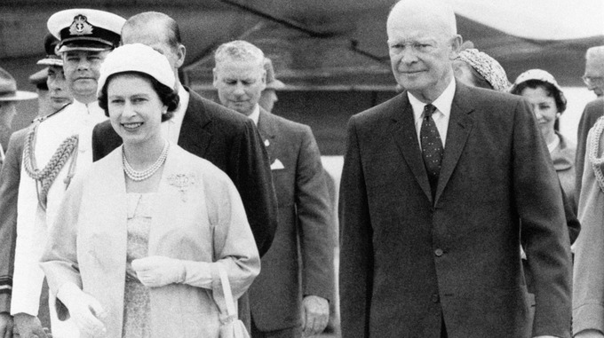 Queen Elizabeth II and US President Dwight D. Eisenhower leaving an airstrip at St. Hubert in Quebec.