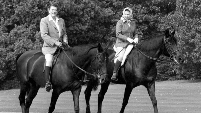US President Ronald Reagan and Queen Elizabeth II riding in Windsor Home Park.