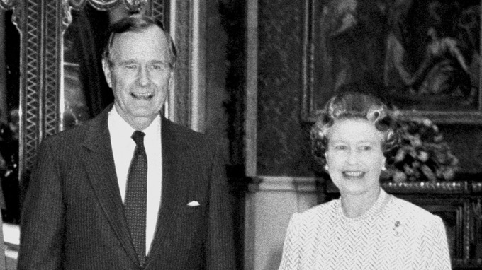 S President George Bush standing with Queen Elizabeth II in the Picture Room at Buckingham Palace in London.