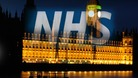 NHS Logo over Westminster