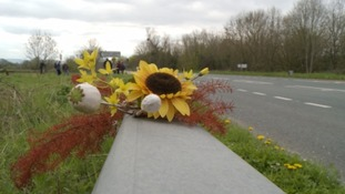 Flowers left on the side of the A358 - where the roundabout will eventually be built