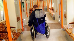 A disabled customer on a train.