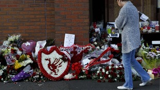 Tributes left at the Hillsborough Memorial outside the football ground at Anfield, Liverpool.