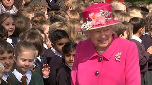 The Queen greets children on her way to the bandstand