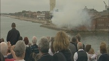 Crowd watching a gun salute