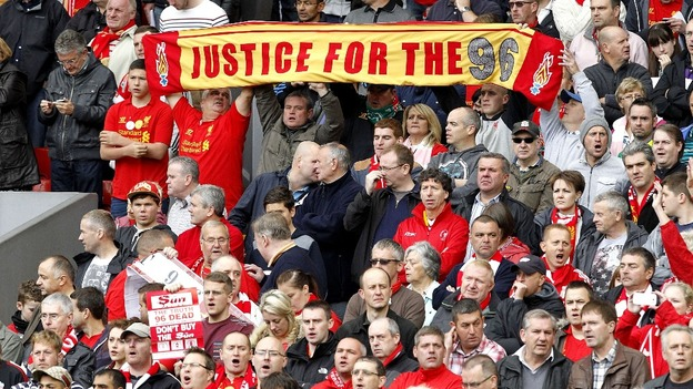 A Liverpool banner honoring the victims and supporting the families affected by the Hillborough disaster prior to the match at Anfield.